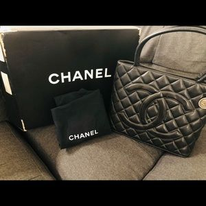 Authentic Chanel medallion tote black caviar skin